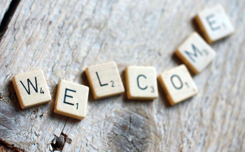 Photograph of Scrabble letters arranged to form the word Welcome.