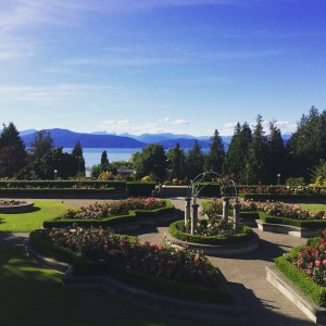 Formal garden with lake and mountains in the background.
