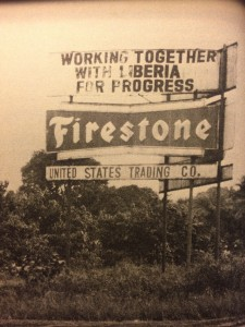 Sign in Firestone plantation in Liberia which reads, Working together with Liberia for Progress: Firestone. United States Trading Co.