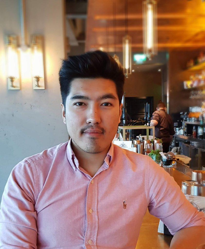 Milan Gurung seated in a bar