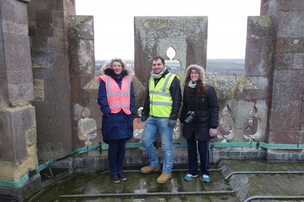 "Heather Newton, Head of Stone Conservation of Canterbury Cathedral (left) and students of the MSc programme in Architectural conservation on the top of ""Bell Harry"", the central tower of Canterbury Cathedral."