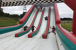 Gung-Ho! participants on a slide