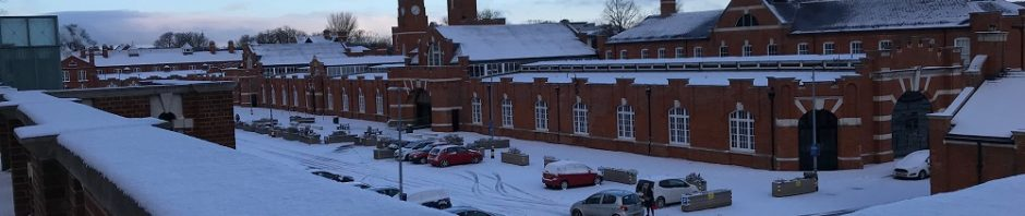 The Drill Hall Library and car park in the snow