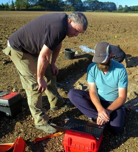 Lloyd and Andy discussing the latest geophysics results and where best to locate Trench C.