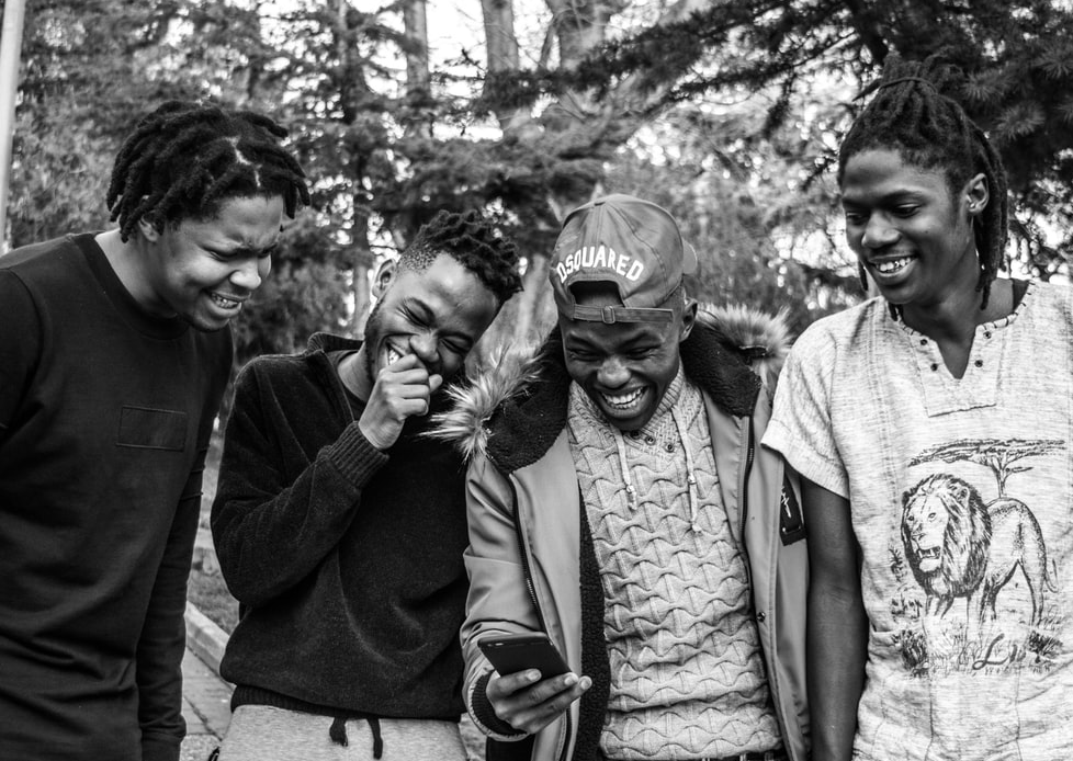 young black men laugh together