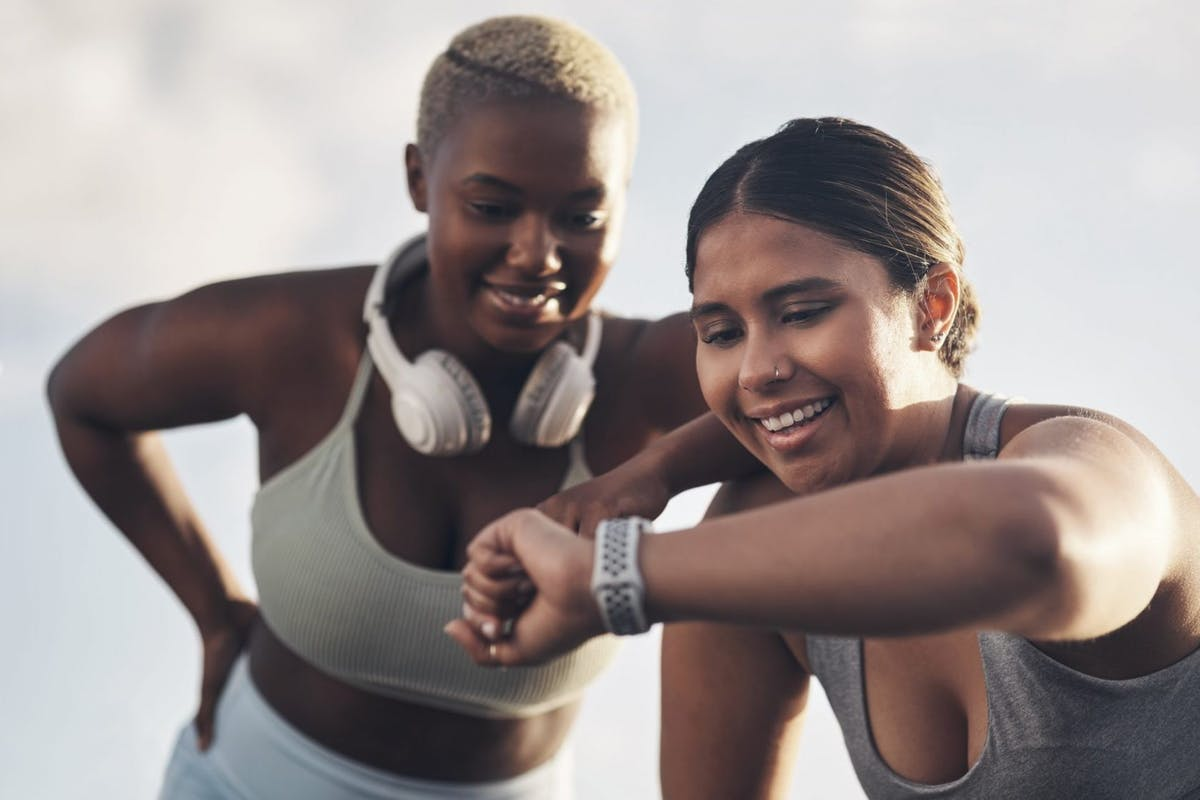 Two women happy in the gym.