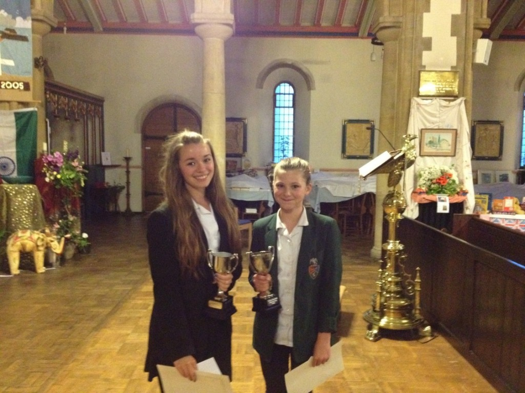 A picture of the winners of the 2012 Dickens Reading Competition, Johanna Pearson Farr and Lizzie Friend