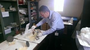 Dr Brad Beaven preparing the Lest We Forget exhibition