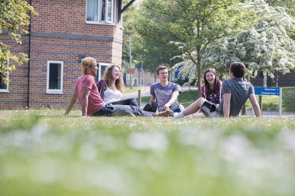 Students outside on the grass in Parkwood