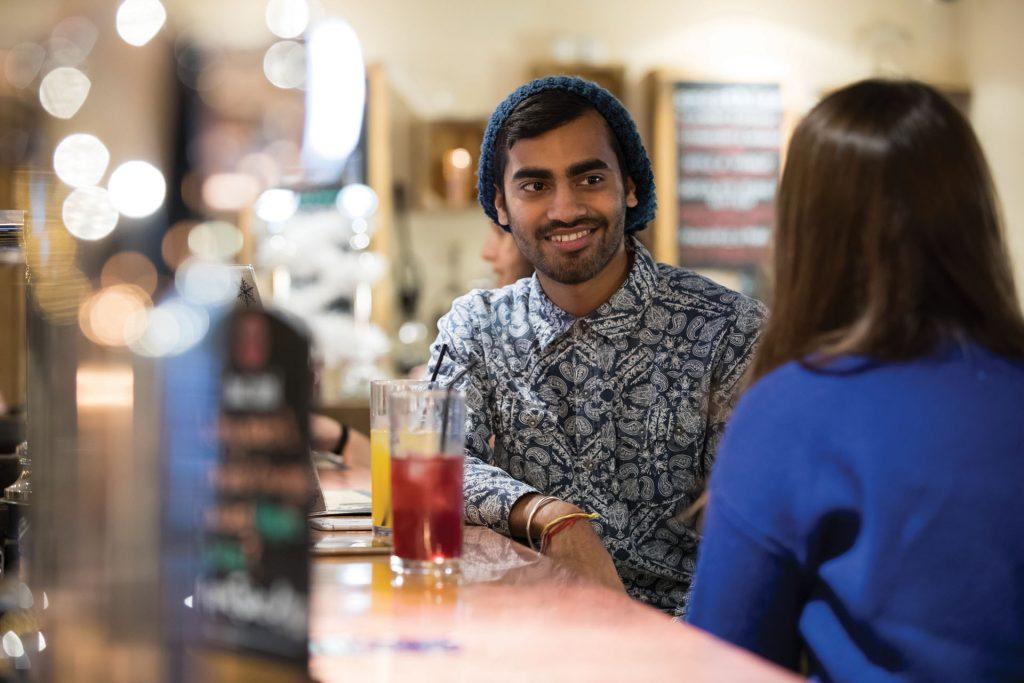 Two students sat at bar
