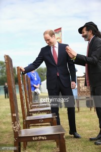 Prince William with artist Hew Locke, who designed 'The Jurors'.