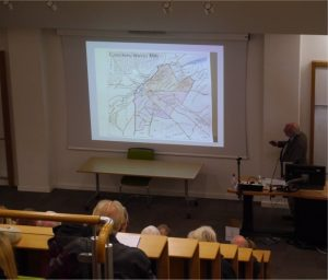 Tim Tatton-Brown presenting a map of Canterbury as it would have looked in 1086.