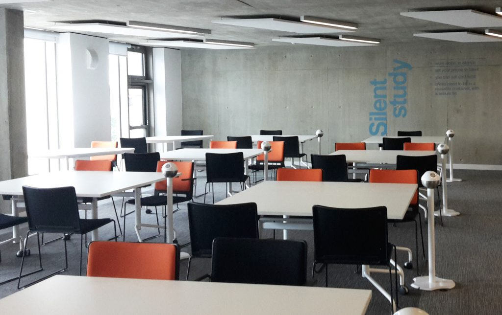 The desks with sensors are in the silent study zone on Floor 2 West, by the windows on the north side of the building. If you enter the area from the direction of the main staircase, they're on your right.