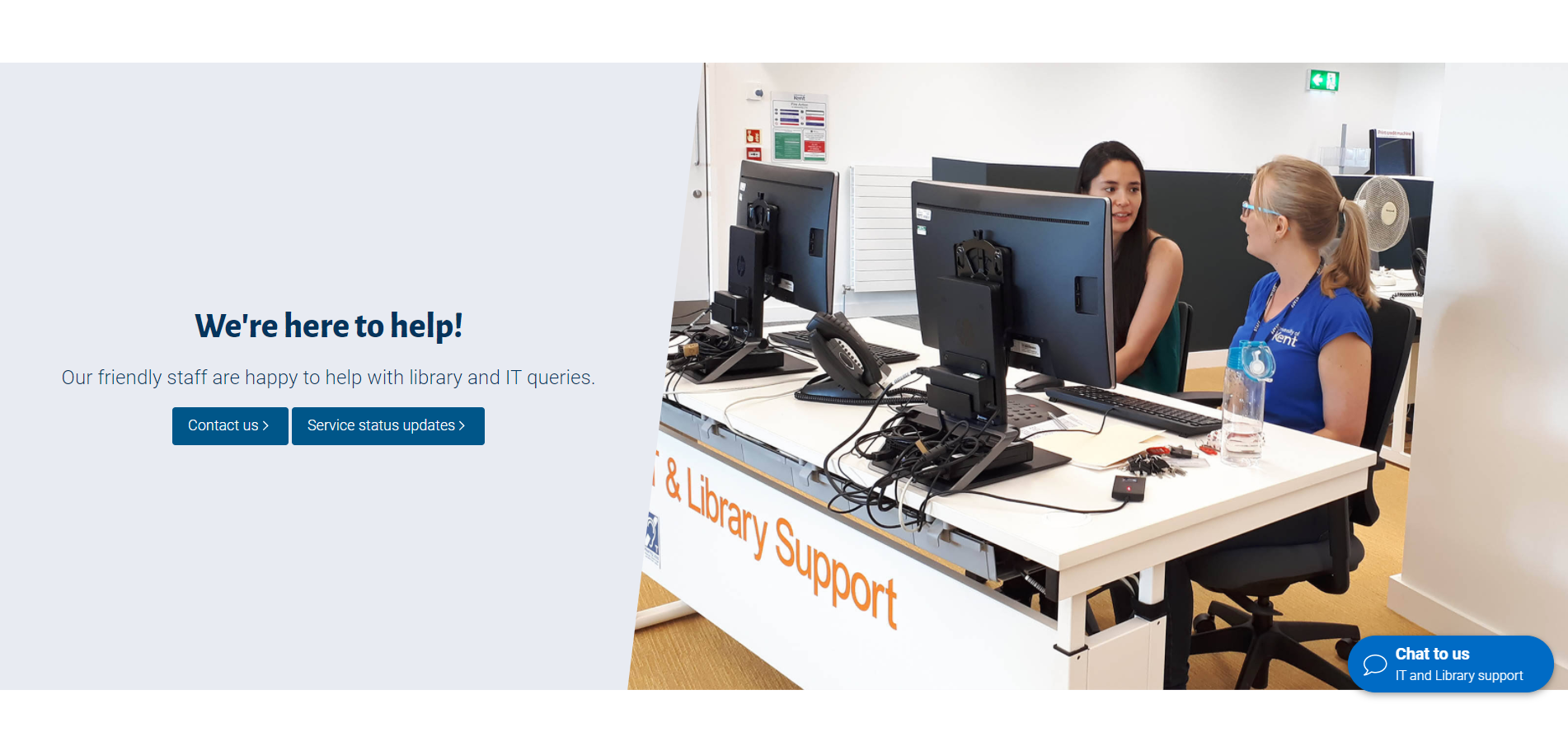 Image of student with staff member at the IT & Library Support Desk in the Templeman Library