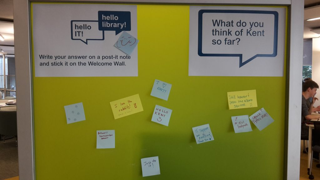 "Post-it notes on the Welcome Wall, answering the question ""What do you think of Kent so far?"""