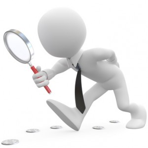 Businessman with magnifying glass looking for coins