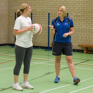 Louisa Arnold coaching netball during staff lunch breaks