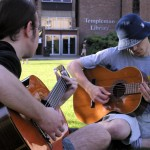 An image of guitar playing students at the University of Kent