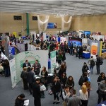 An image of stands and students and the University of Kent careers fair