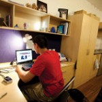 An image of a student in a student bedroom