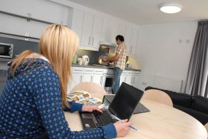 An image of students in a shared student flat at the University of Kent