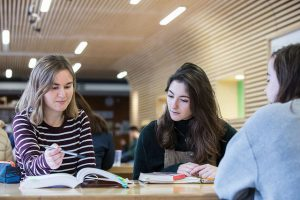 An image of university of kent students studying texts
