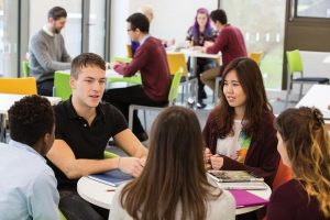 Students studying at a table at the University of Kent