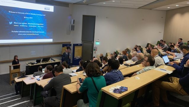 an image of delegate in a tiered lecture theatre listening to a talk