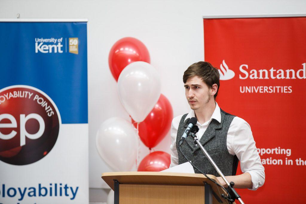 Tyler Hamblin intern standing at a podium
