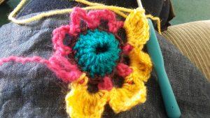 Yarn bomb flower