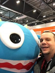 Learning Technologist selfie with company mascot