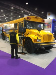Picture of yellow American School bus in the BETT tradeshow