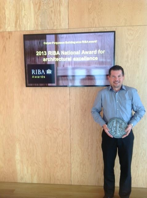 Mark Ashmore bearing the award