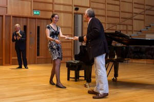 Alex Turner receives her award from Jonathan Monckton