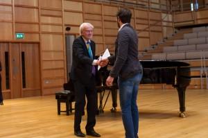 John Craven presents Gordon Wood with his award