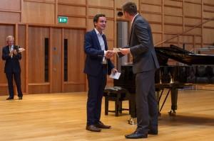 Matthew Bamford receives his award from Dan Lloyd