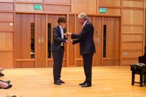 First-year Joe Prescott receives his award from Keith Mander
