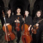 Faith Chan (l) with members of the cello section at the Cathedral Concert