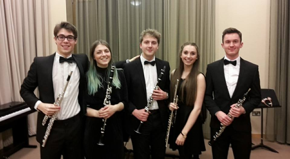 Tom (centre) with the woodwind section of the Symphony Orchestra