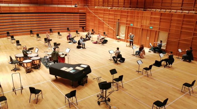 Small steps as in-person rehearsals bring music to the concert-hall once more