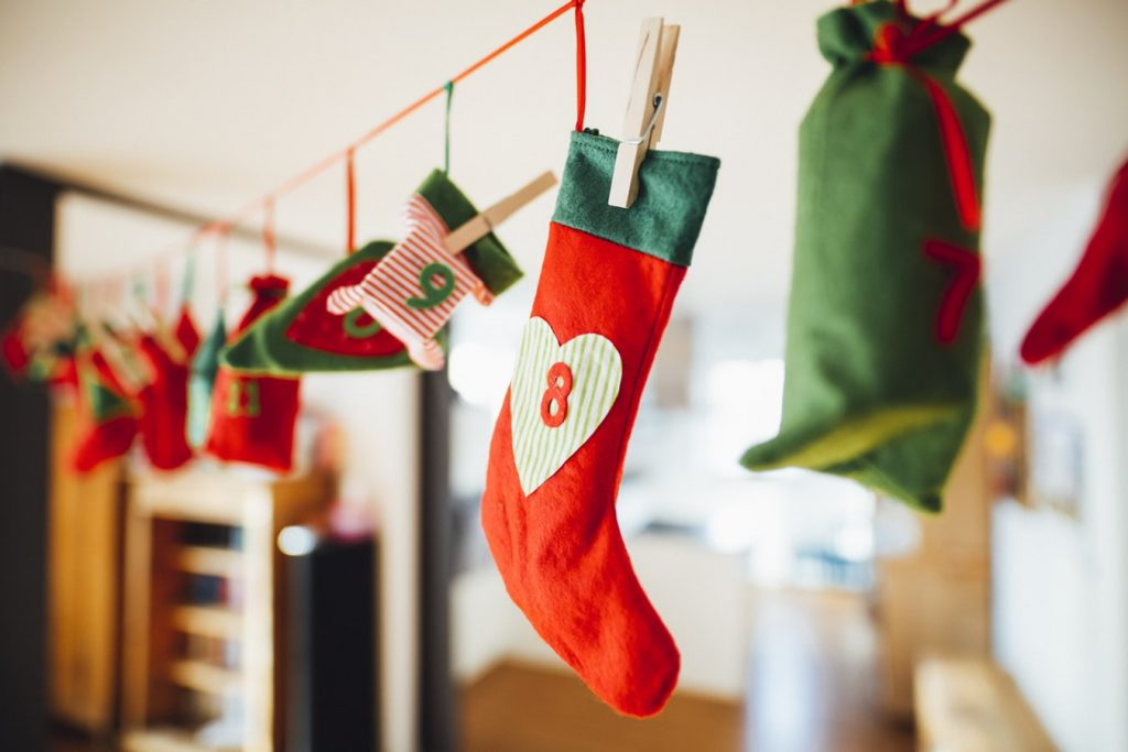 Christmas stockings suspended from string. Each one is individually numbered for the advent period.