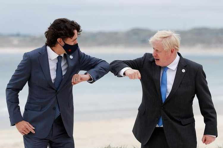 Trudeau and Johnson bump elbows at the G7 conference this month