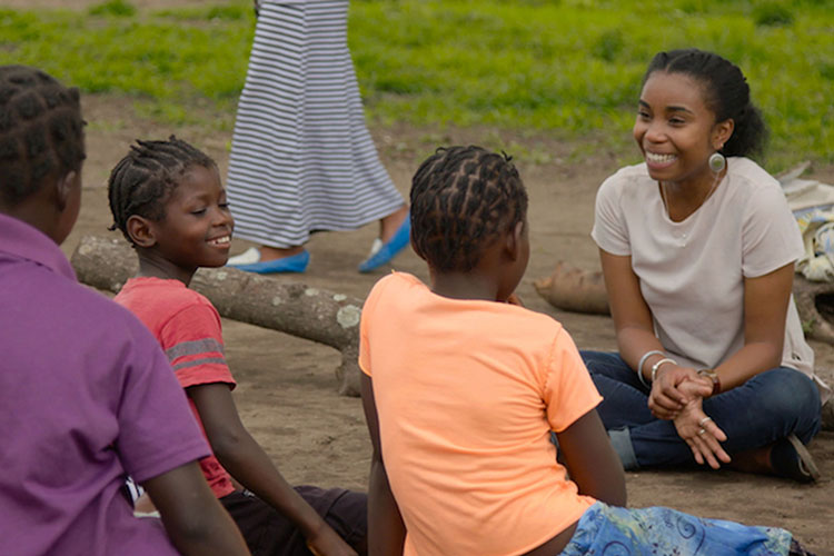 Dominique Gonçalves laughing with a Girls Club group in Gorongosa.