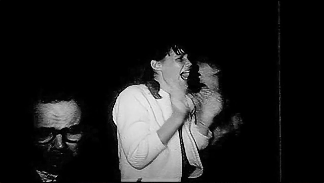 A screaming fan at a Beatles concert.