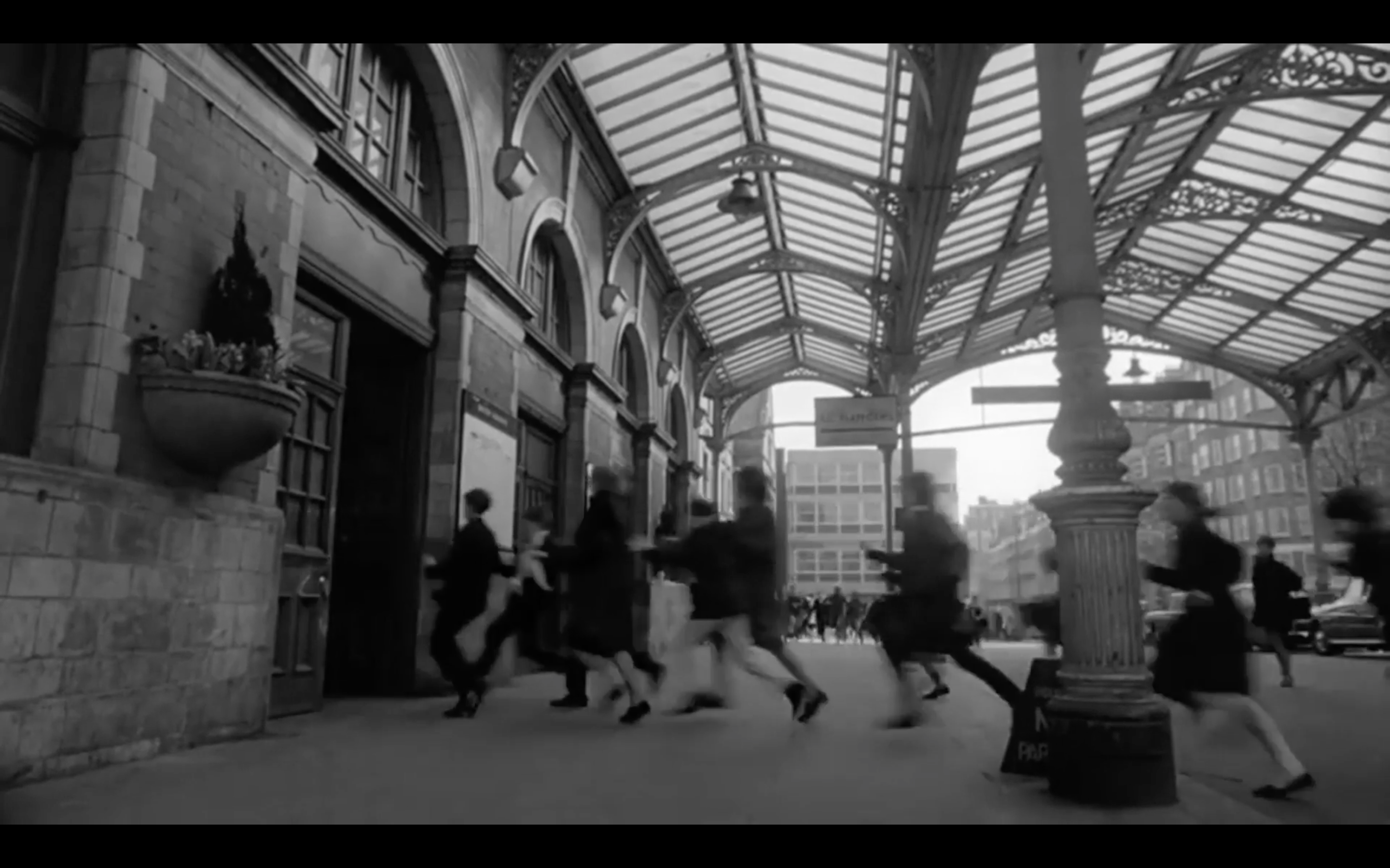 Archive footage of girls running for a train to get to a Beatles gig.