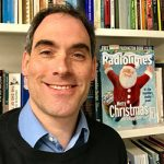 Chis Deacy in front of a copy of the Christmas Radio Times 2017 edition