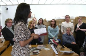A student reads from her work