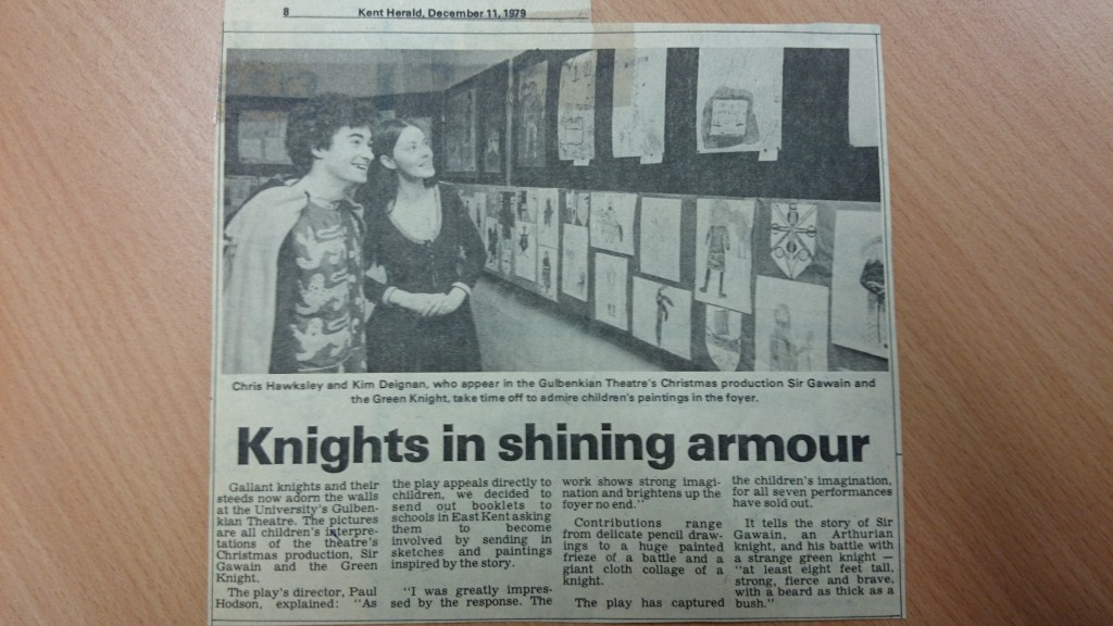 Article from the Kent Herald featuring a picture of cast members with school children's artwork