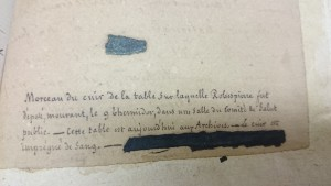 The fragment of leather and it's intriguing caption (in French)