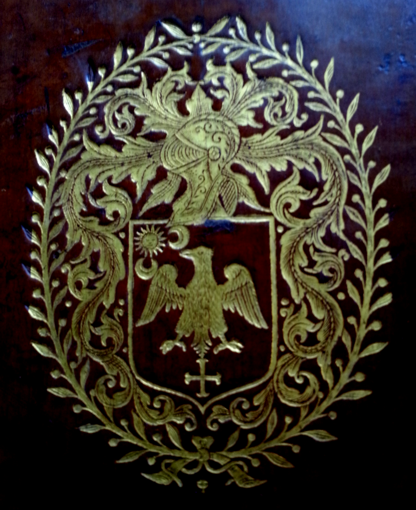 Gold tooled coat of arms on the front cover of 'Sancti Bonaventurae ex Ordine Minorum S.R.E. Episcopi Card. Albanen. eximii Eccles. doctoris Opera'